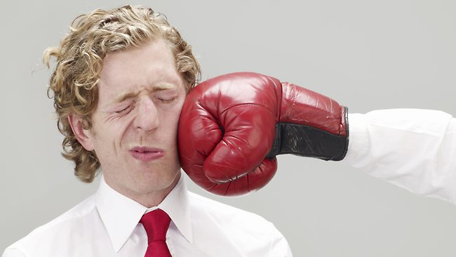 718614-businessman-punched